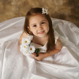 young bridesmaid with flower in her hair