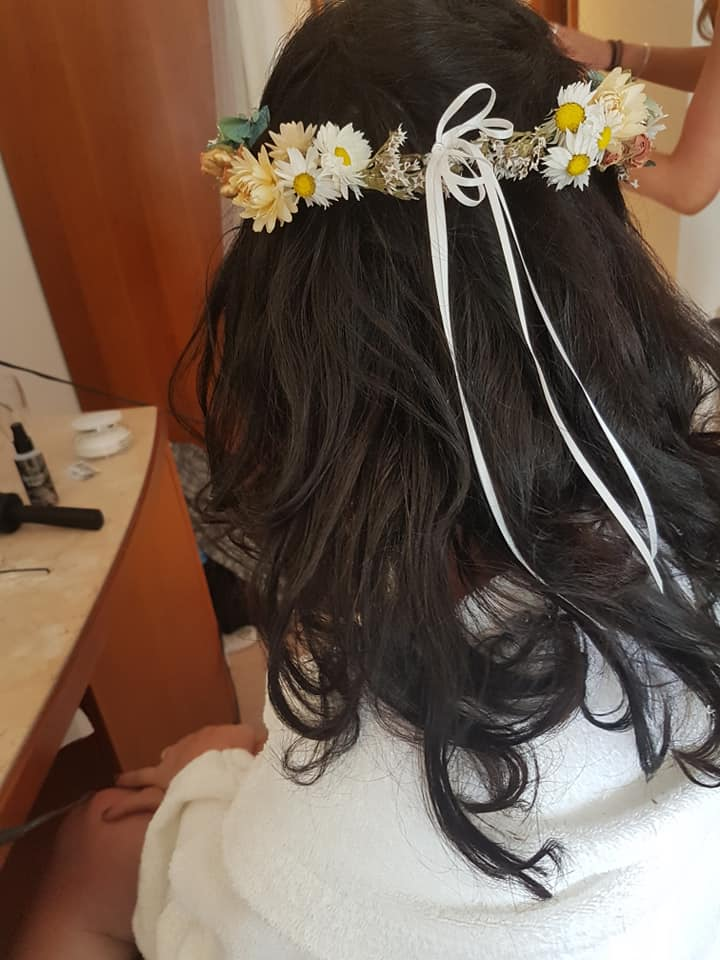 woman with boho wedding hair style with flower band